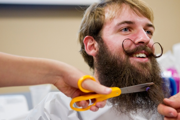 "Alex Michalak, a junior bio-chemistry major, has his beard cut and later shaved at the ""Movembeard"" celebration on Saturday, Dec. 1, 2012 at Nebraska Wesleyan University in Lincoln, Neb. Participants grew facial hair all of November to raise money and awareness for prostate cancer research. He has been growing his beard and mustache since Aug. 14, 2011."